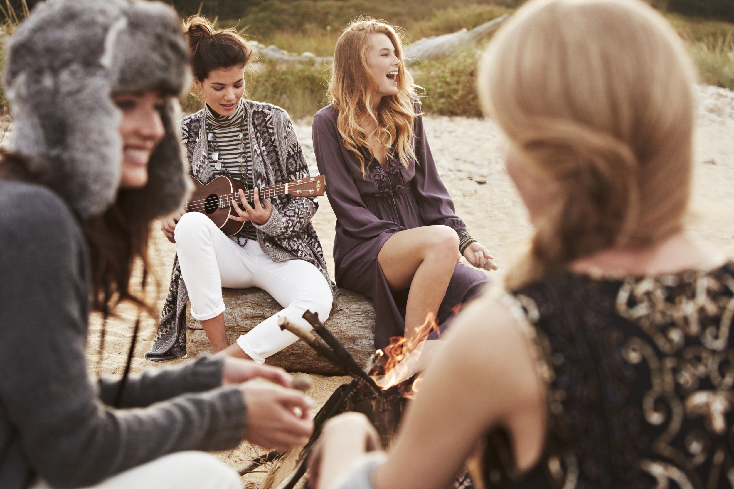 photo shoot for calypso st barth in the hamptons at a bonfire
