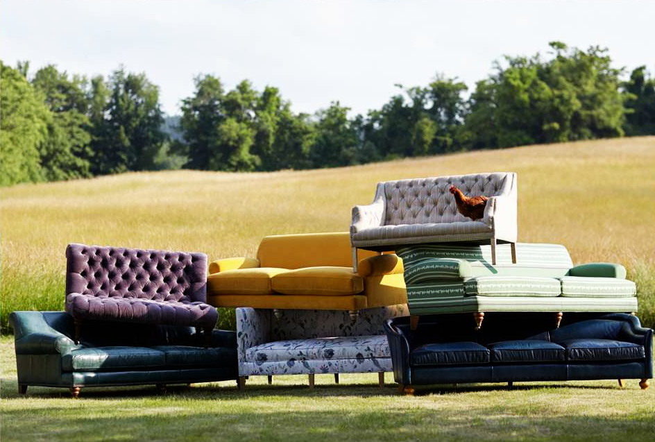 anthropologie house and home catalog couches in a field with a chicken