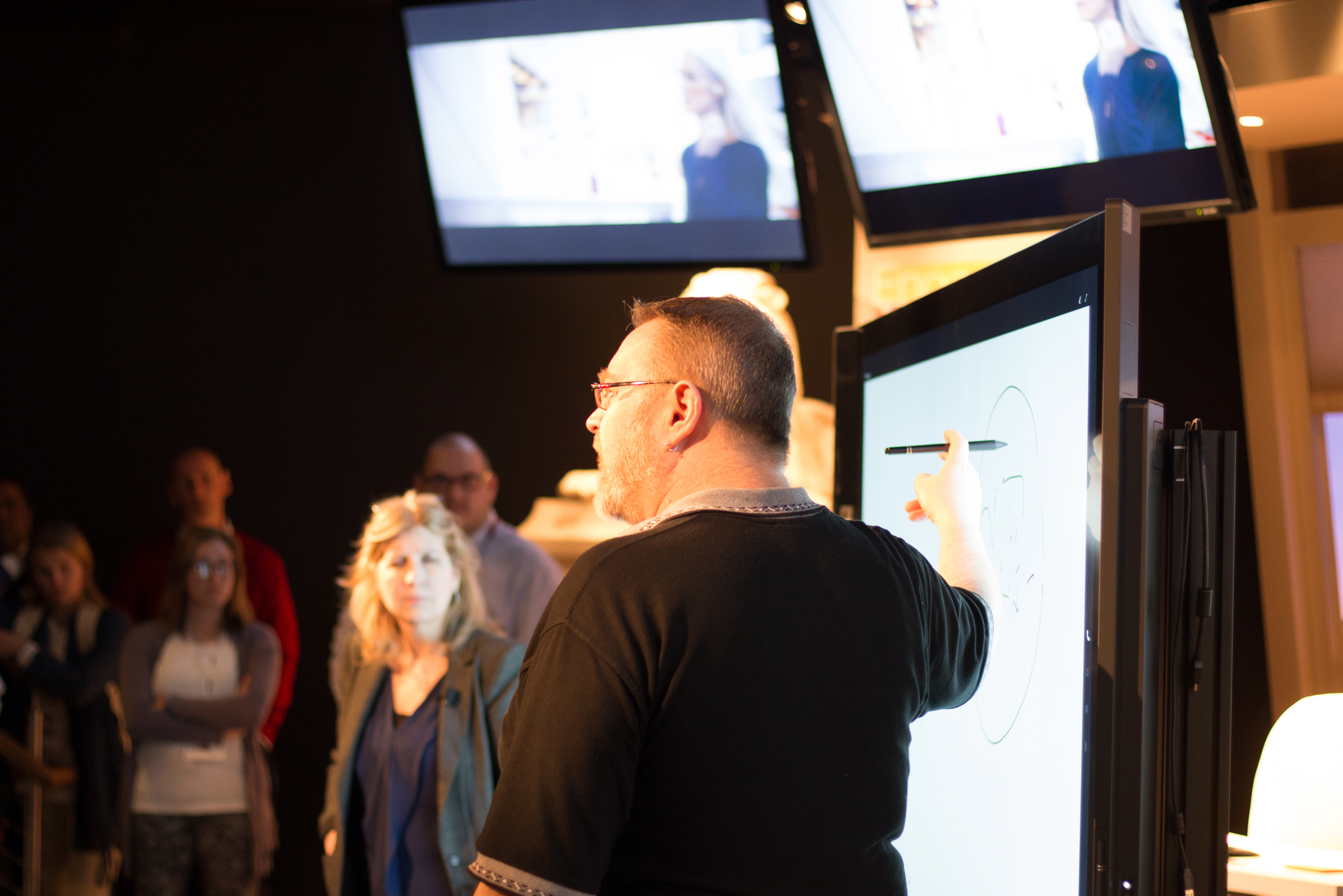 Students get an overview of the Surface Hub interactive display from Microsoft Technology Architect, Stephen Jeffries.