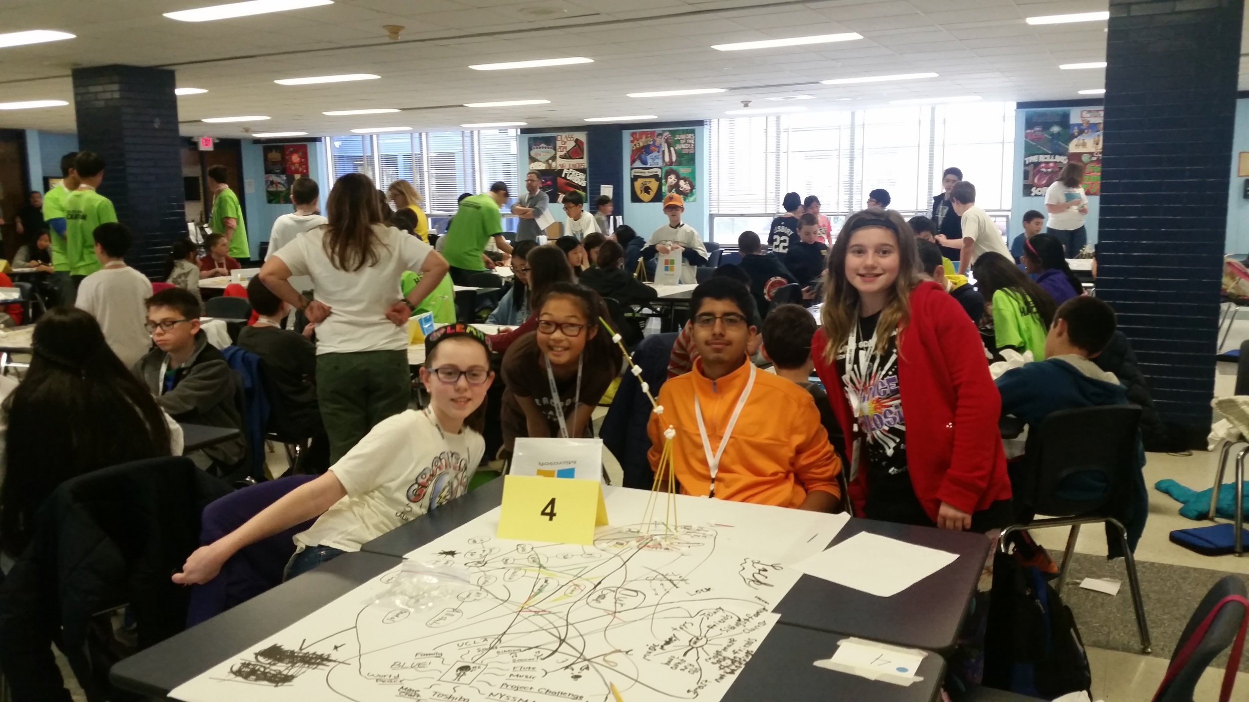 Student team poses for a photo during our mind mapping session, during which students use visual representations of their identity to introduce themselves to one another and get comfortable with their teammates.
