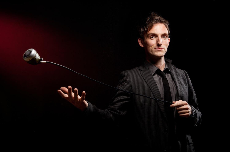 band-singer-throwing-vintage-microphone-red-light-shayne-gray.jpg
