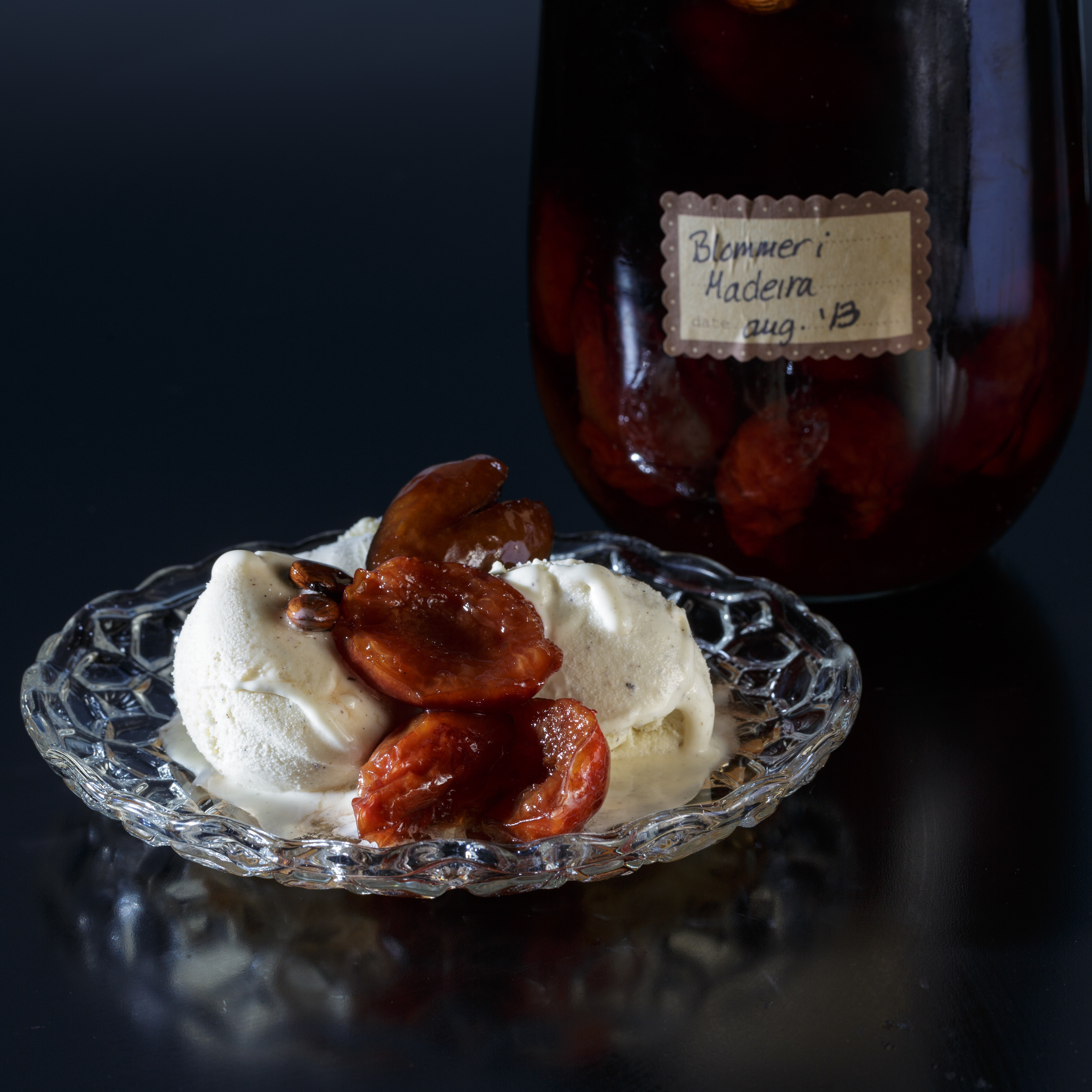 Plums in Madeira served over vanilla ice cream