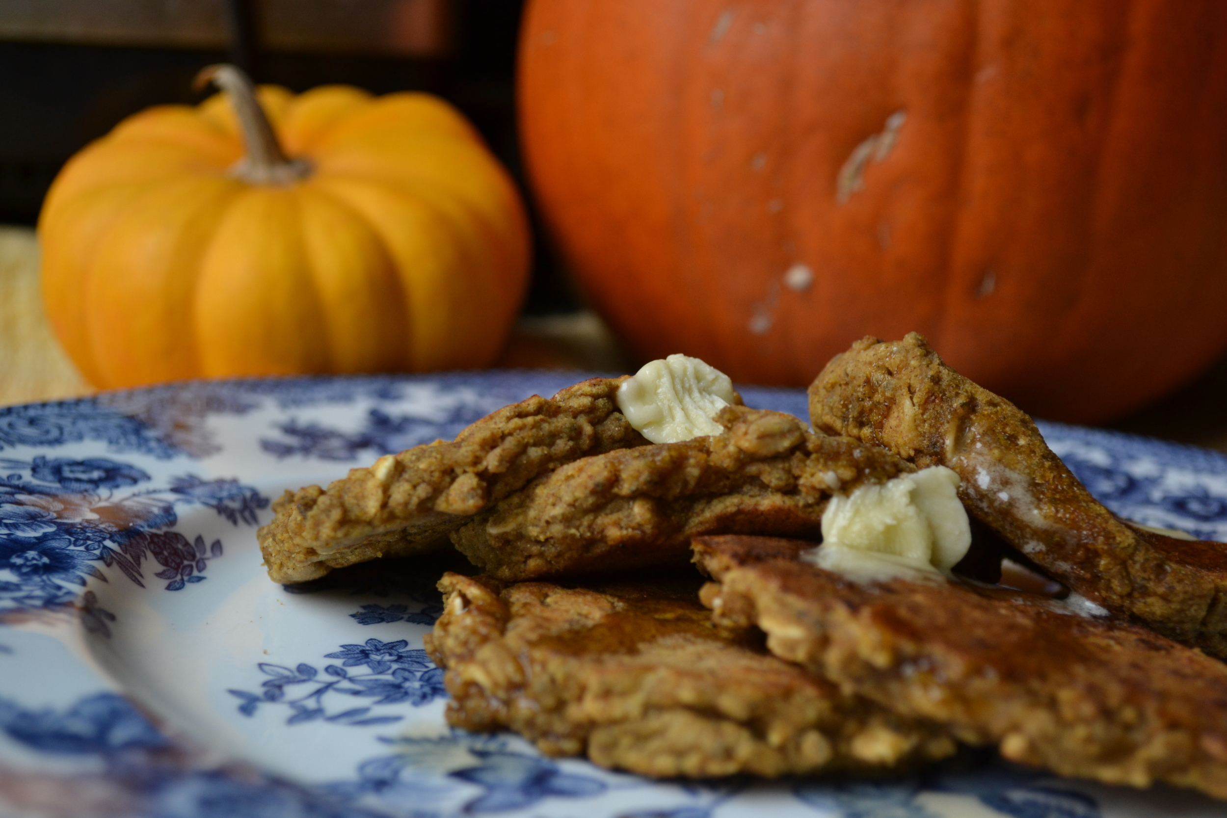 Pumpkin bread pancakes topped with maple syrup and bit of Earth Balance. Photo credit: RMW Nutrition