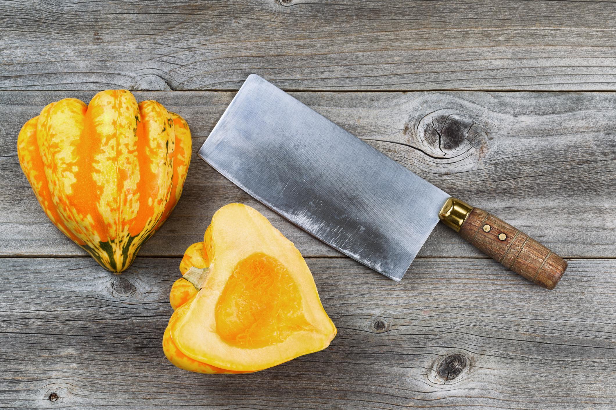 © Tab1962   Dreamstime.com - Freshly Cut Squash With Large Knife On Rustic Wood Photo