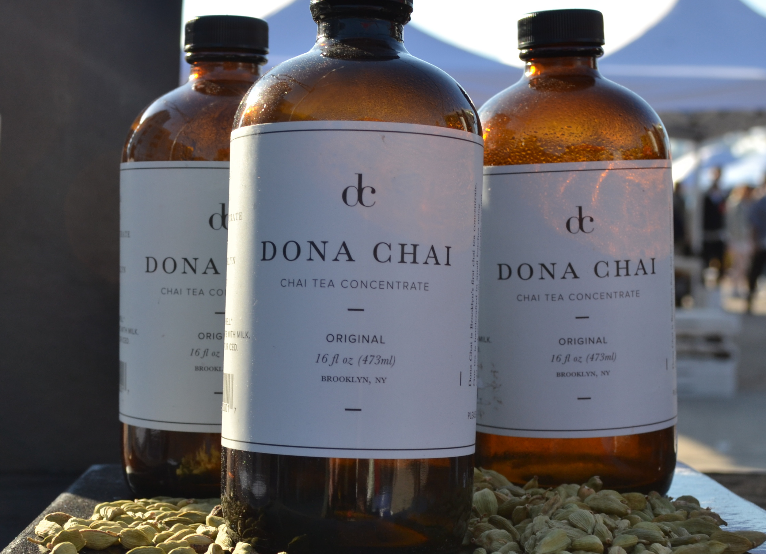 Almond milk iced chai latte for now, bottles of Dona Chai chai tea concentrate for later.