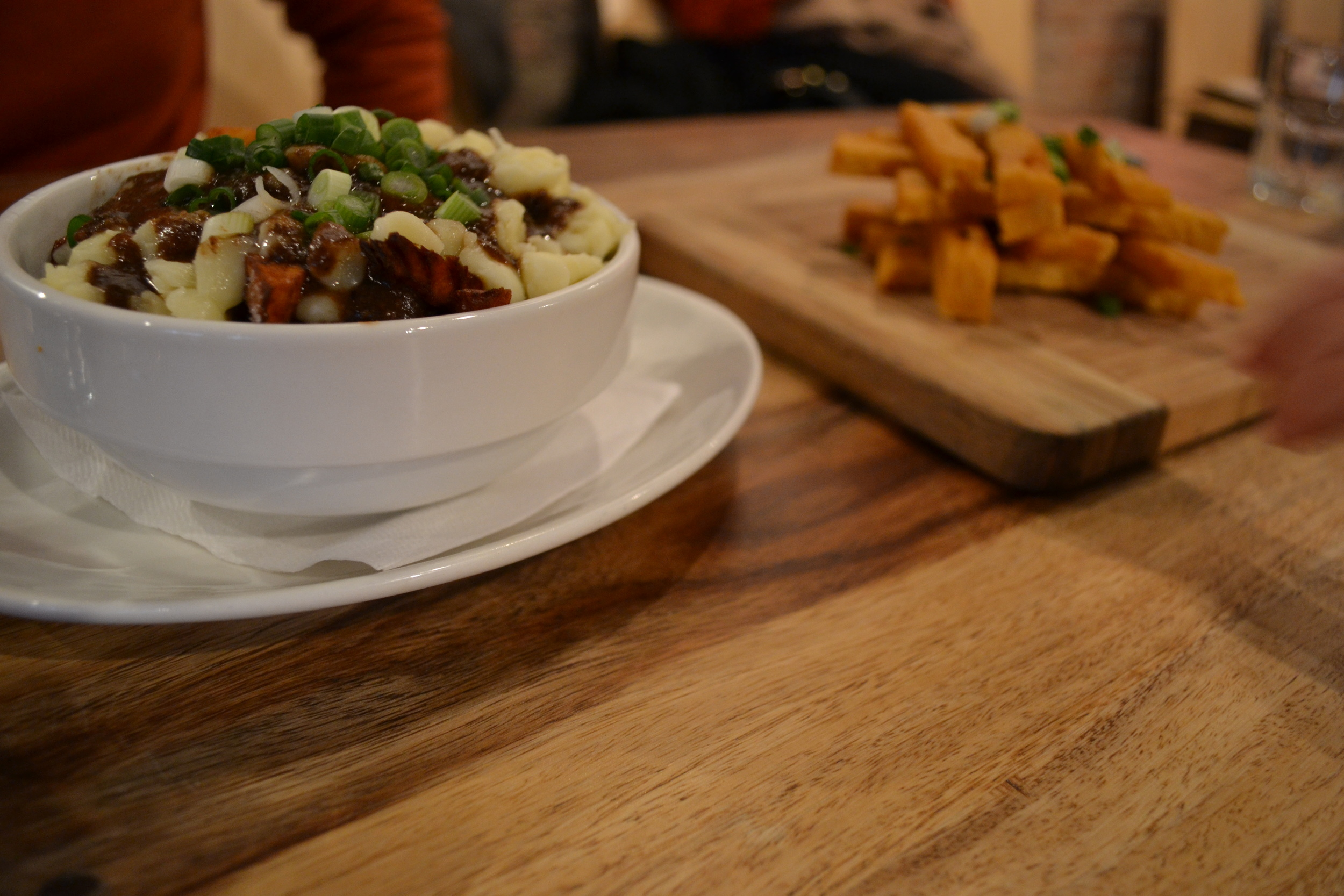 Vegetarian poutine (left) and chickpea fries (right) at Lola Rosa