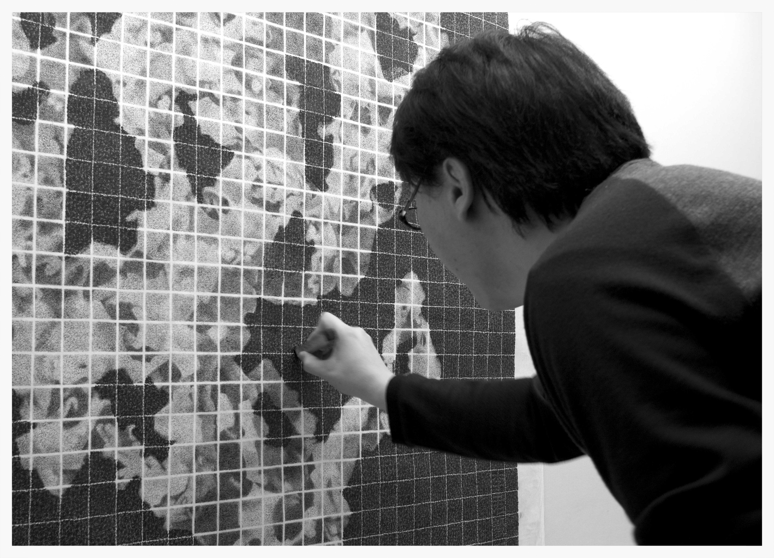 Lee Chun-Yi using his unique cork stamp to compose 'Association of Rock'.