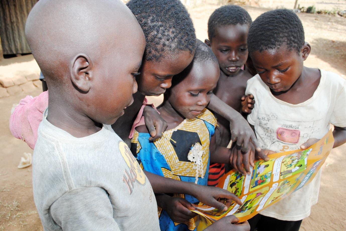 Children looking at an Uwezo Poster, Kumi District, Uganda, April 2012