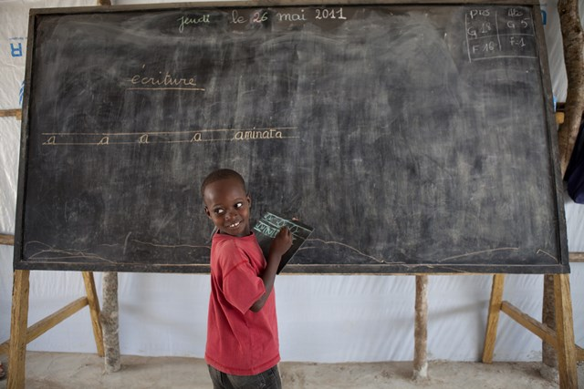 A child attending school in a refugee camp in Liberia. Half of the world's child refugees are out of school.  ©  Save the Children