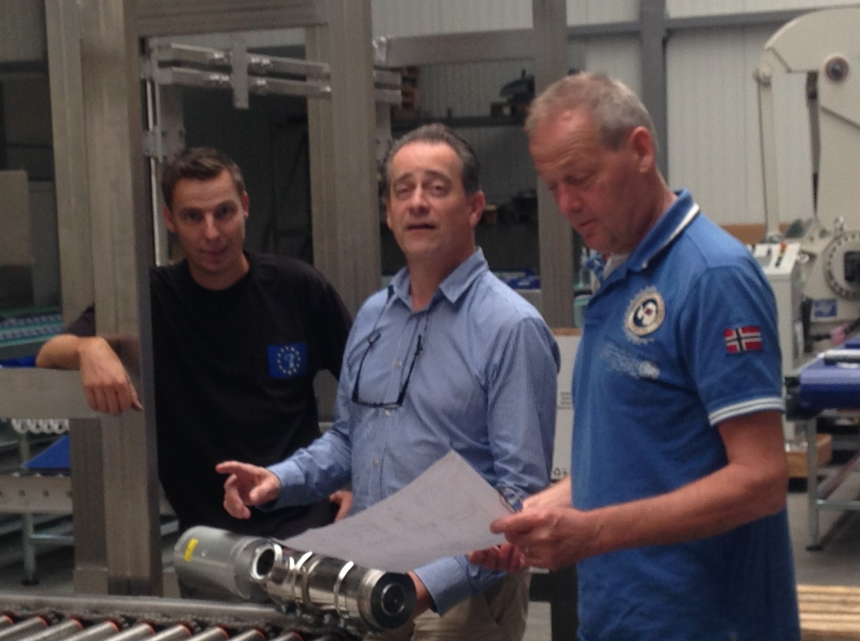 Jan, Patrick and Hans discussing together a new customized filling line.