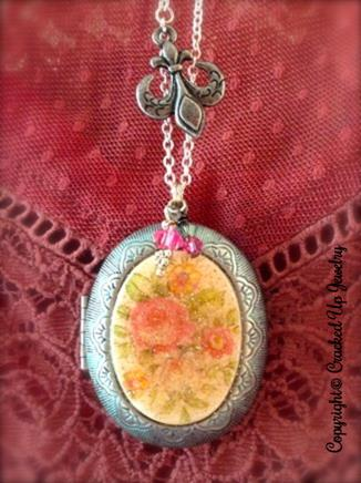 Beautiful floral antique china locket with fleur-de-lis embellishment.