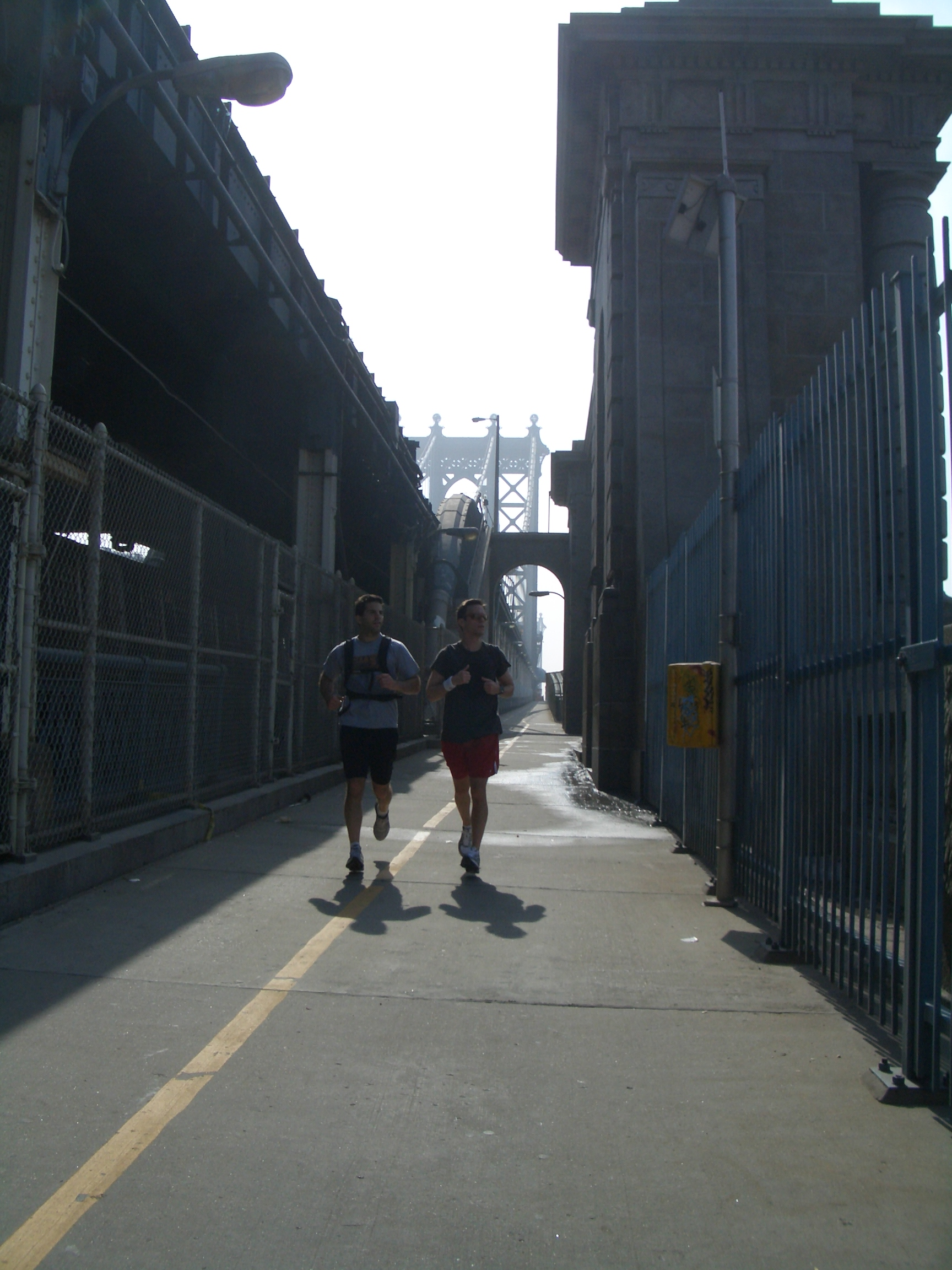 City Running Tours New York City leads a business traveler on a  PERSONALIZED RUN  across the Manhattan Bridge with views of the Brooklyn Bridge and lower Manhattan.