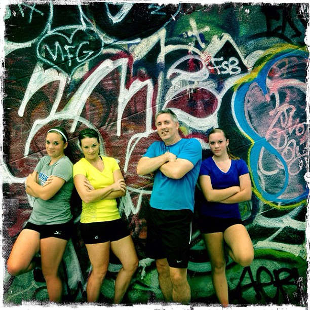 This family of runners stops for a photo in front of some of great graffiti art on the Manhattan Bridge on a New York City Personalized sightrunning tour.
