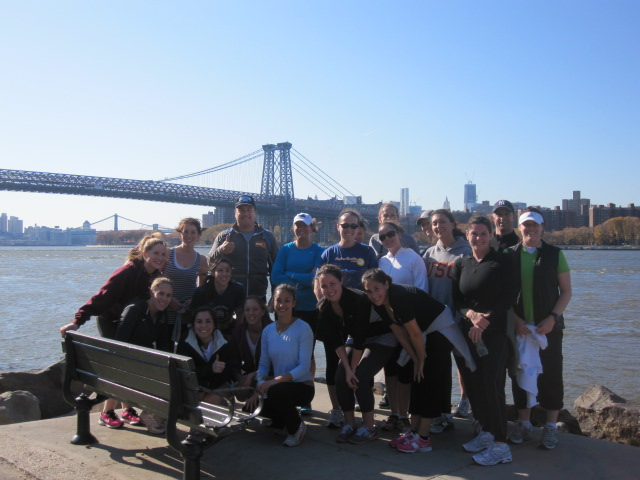 View of the Wiliamsburg Bridge and lower Manhattan on a running tour along the East River in Brooklyn.