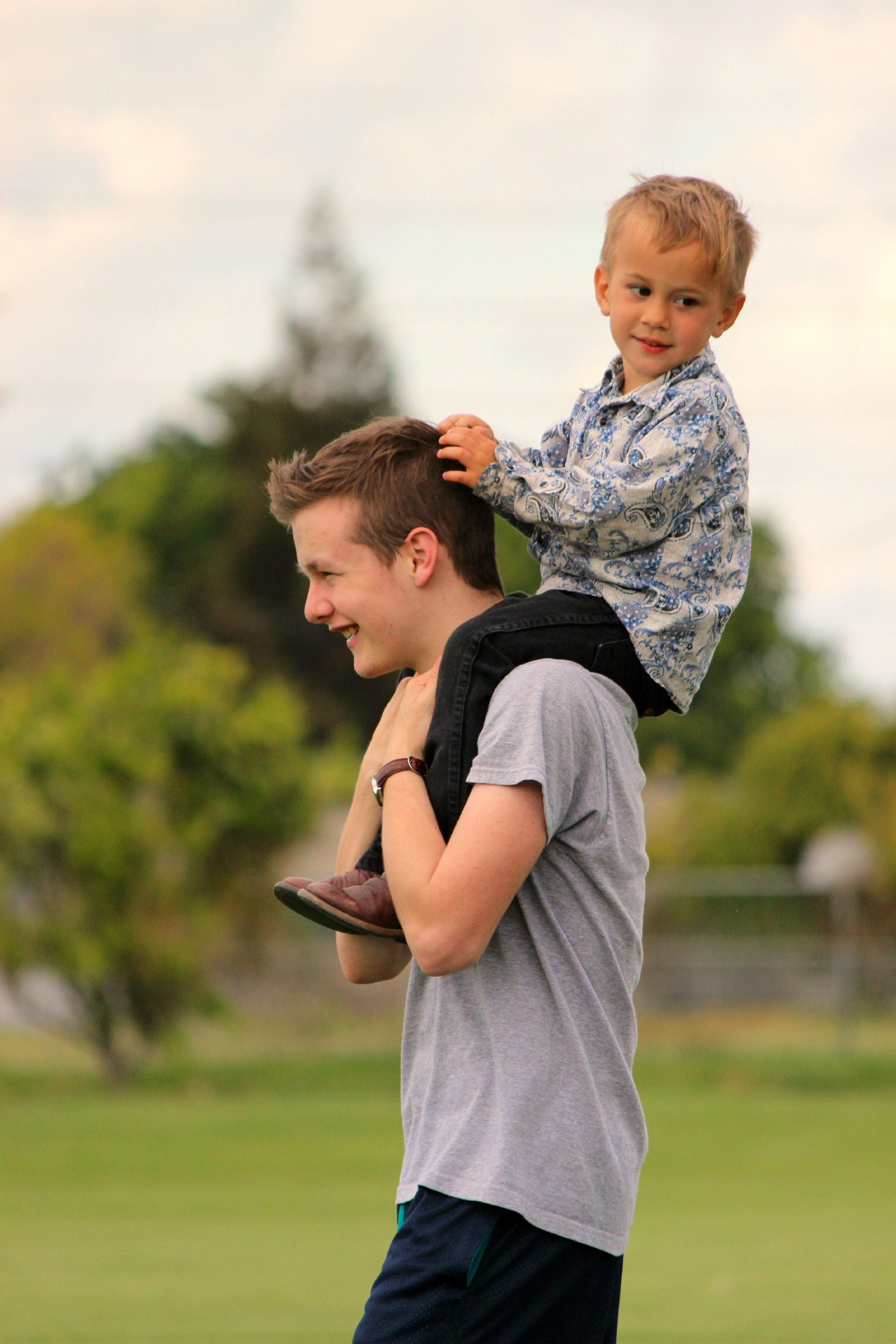 My brother, Justin, giving away free piggy back rides.