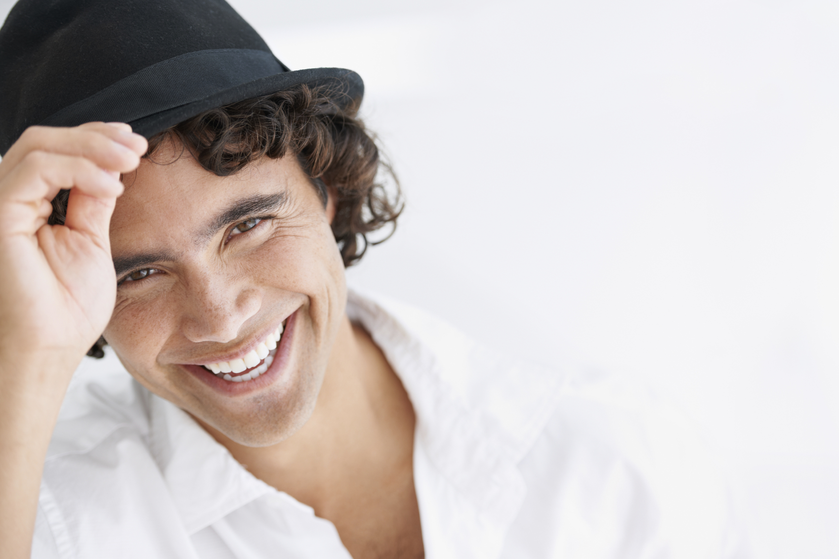 Guy with hat smiling