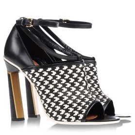 Exposed ankle and peep toe are great perks to this detailed shoe with its geometric heels and black/white pattern.