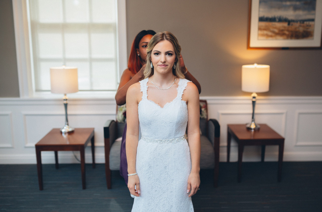bride-getting-dress-on-wethersfield-wedding.jpg