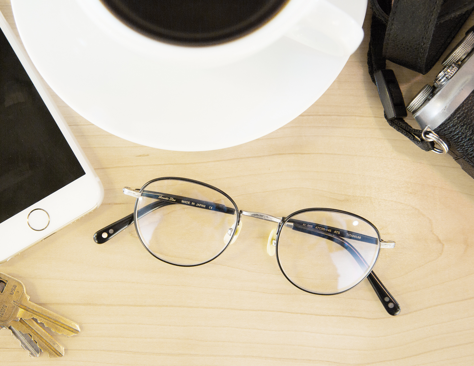 overhead photograph of glasses on a table at a coffee shop | the skulls