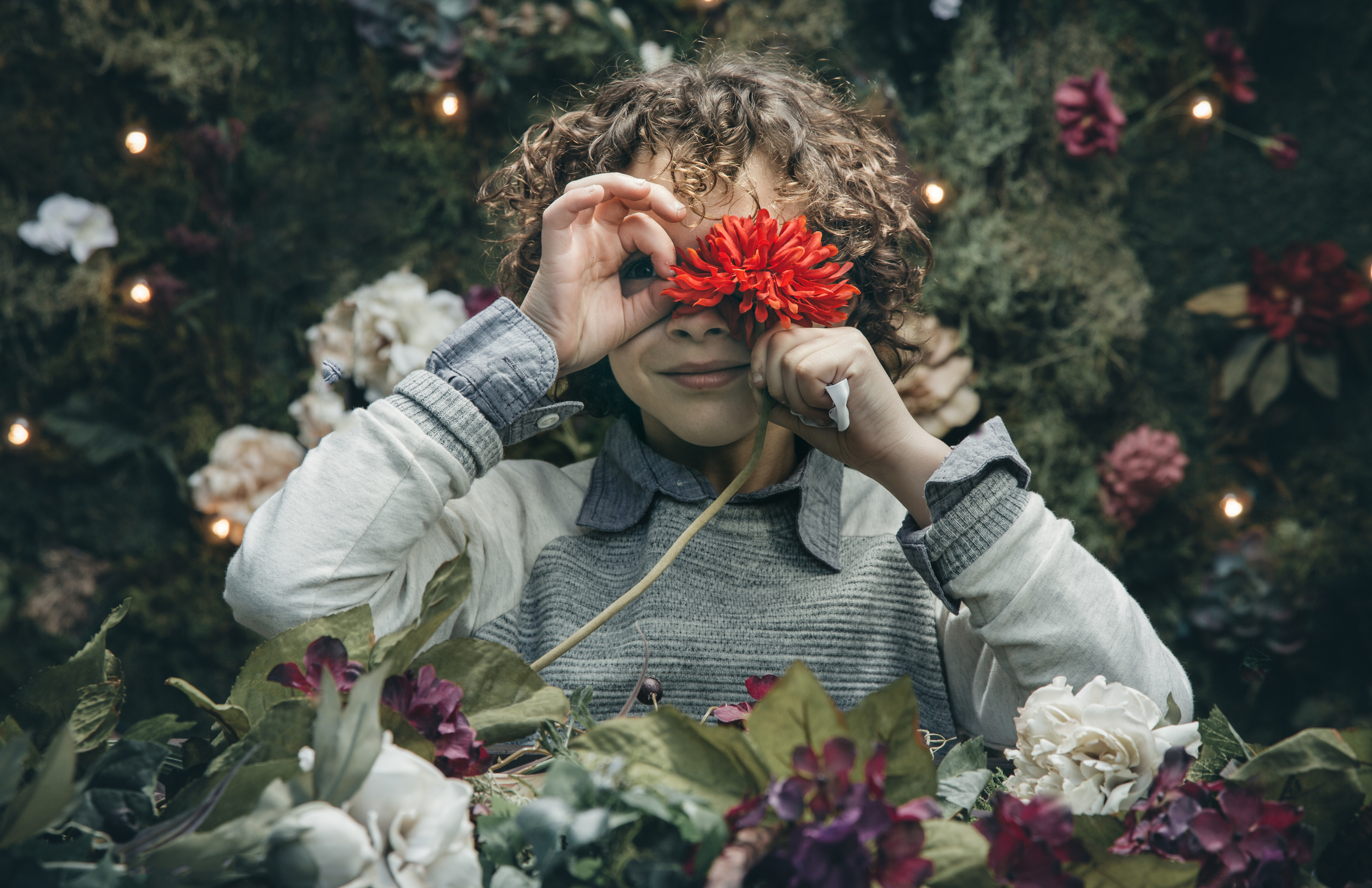boy playing with a flower | the skulls
