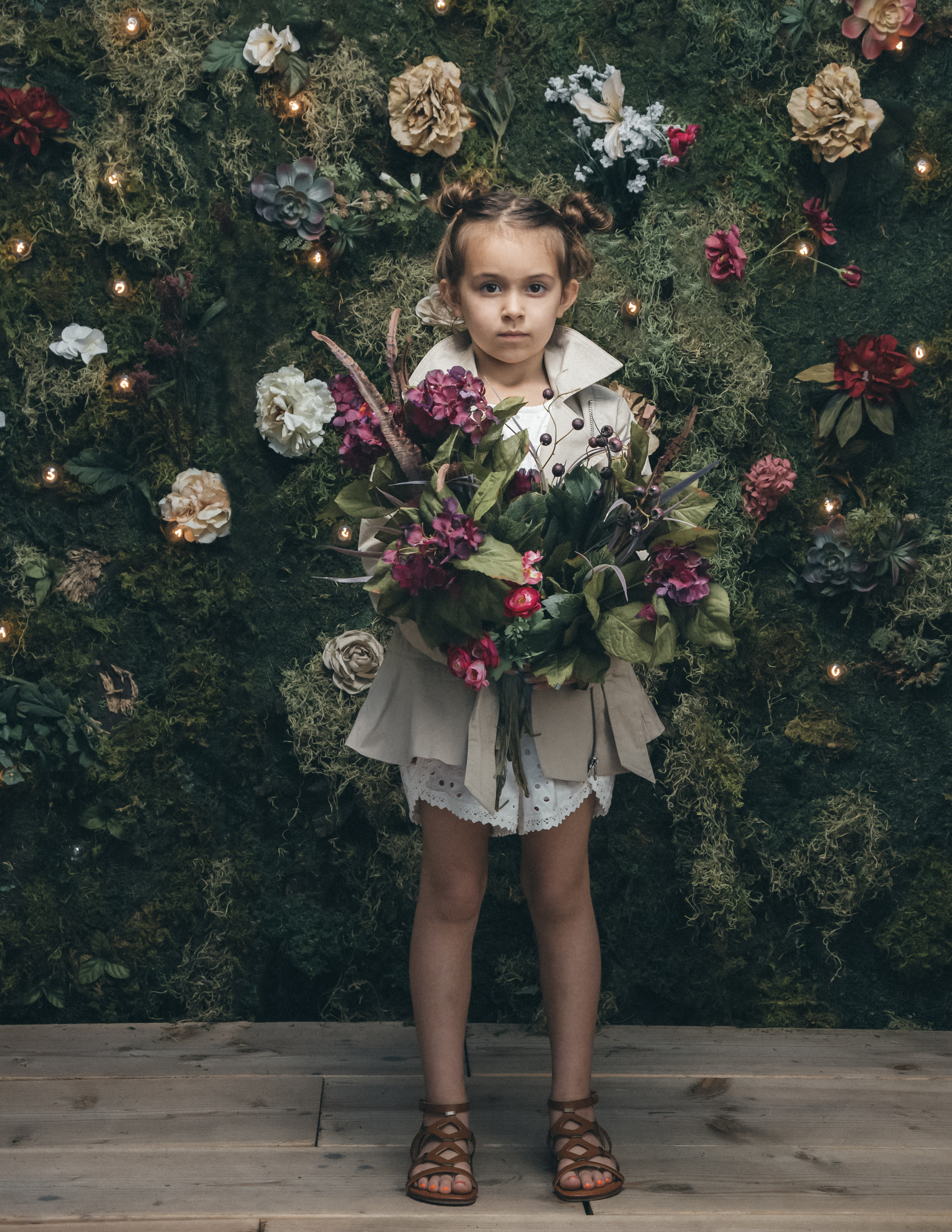 girl with flowers editorial photography by the skulls