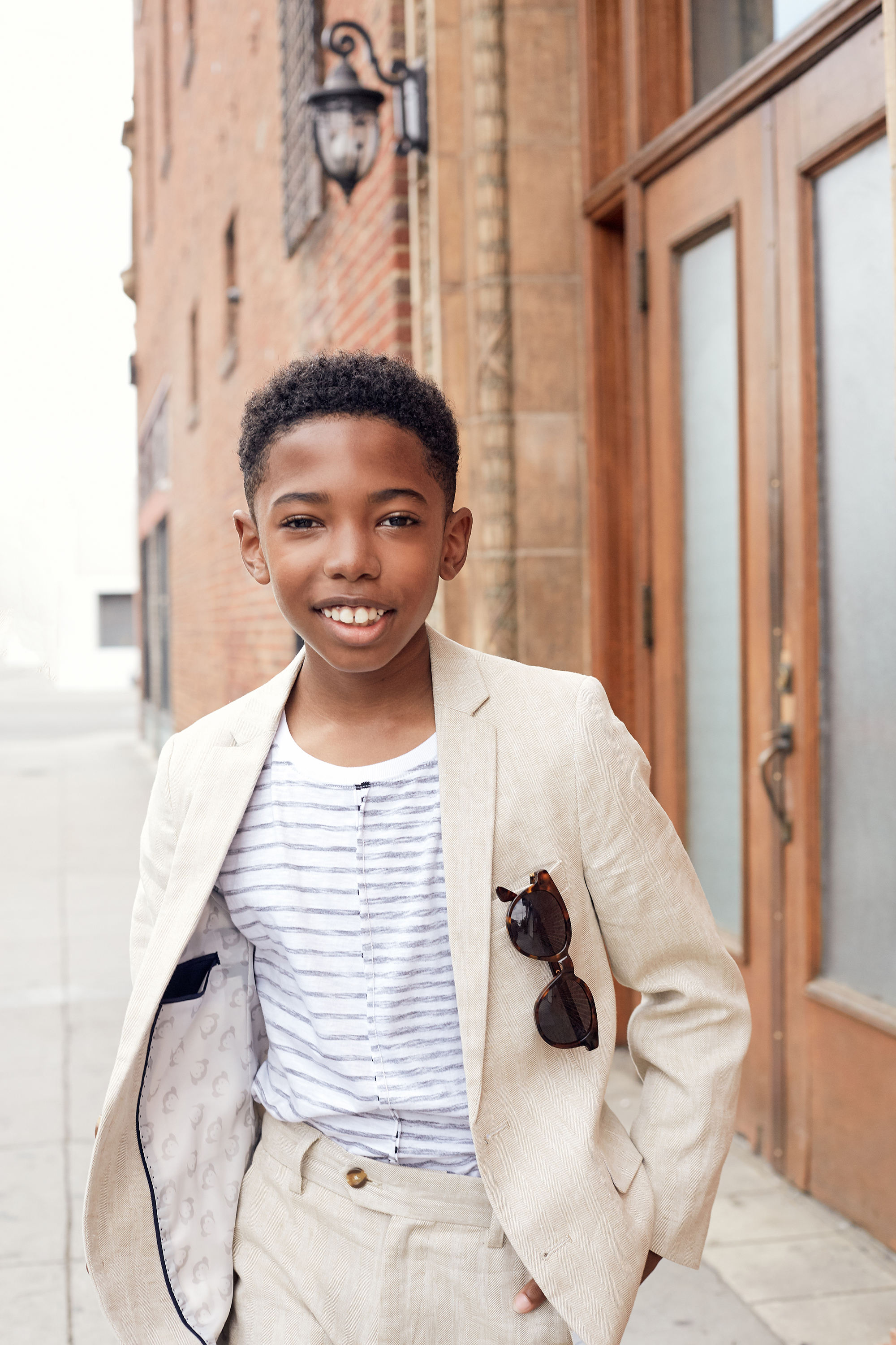 Seth Carr for Posh Kids Magazine  Suit: Appaman T-shirt: Stem Loafers: Florsheim Sunglasses: Retrosuperfuture  Wardrobe - Angelique Fortuna  Grooming - Renee Loiz  Photograph - Ryan Pavlovich