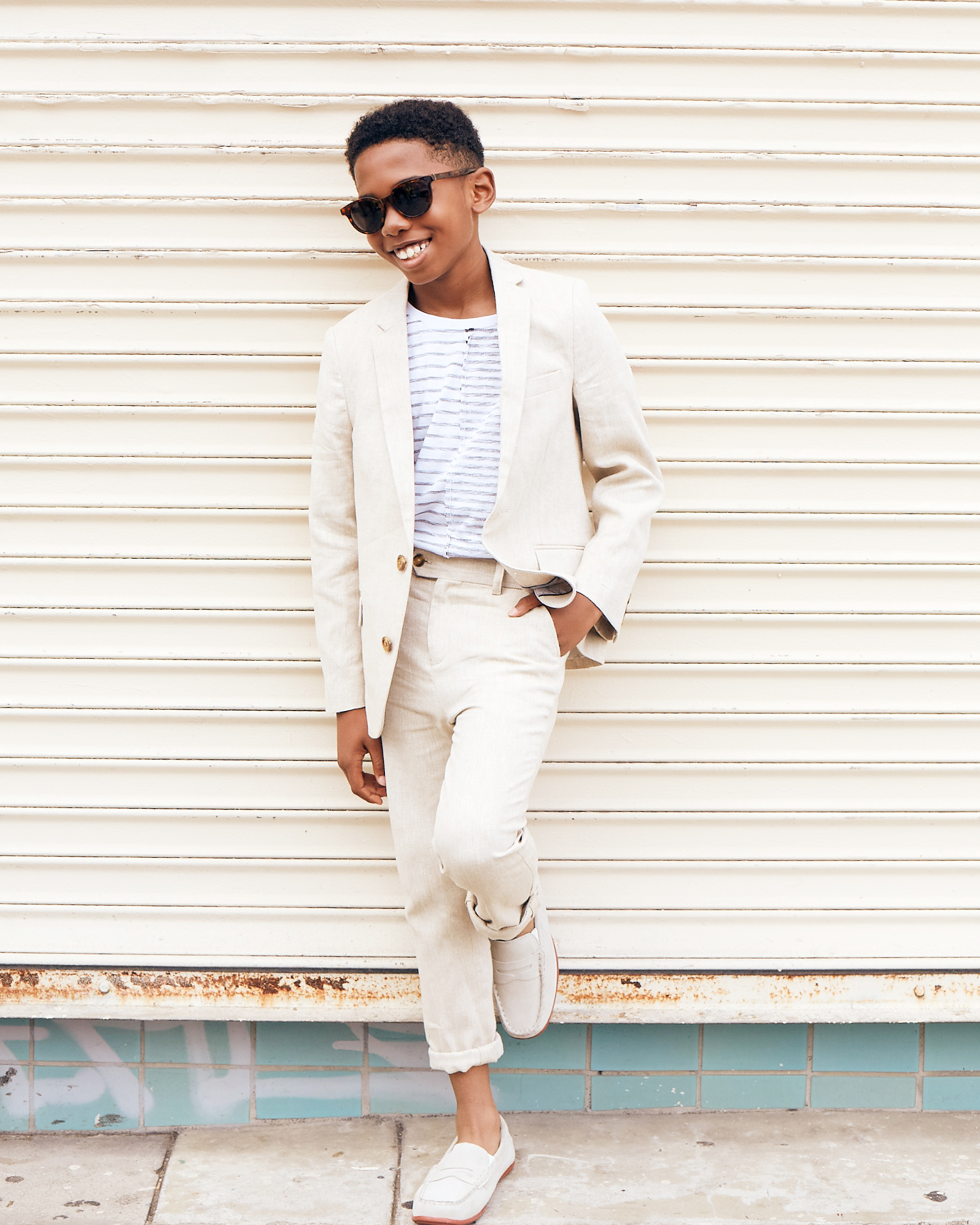 Seth Carr for Posh Kids Magazine wearing:  Suit: Appaman T-shirt: Stem Loafers: Florsheim Sunglasses: Retrosuperfuture  Wardrobe - Angelique Fortuna  Grooming - Renee Loiz  Photograph - Ryan Pavlovich