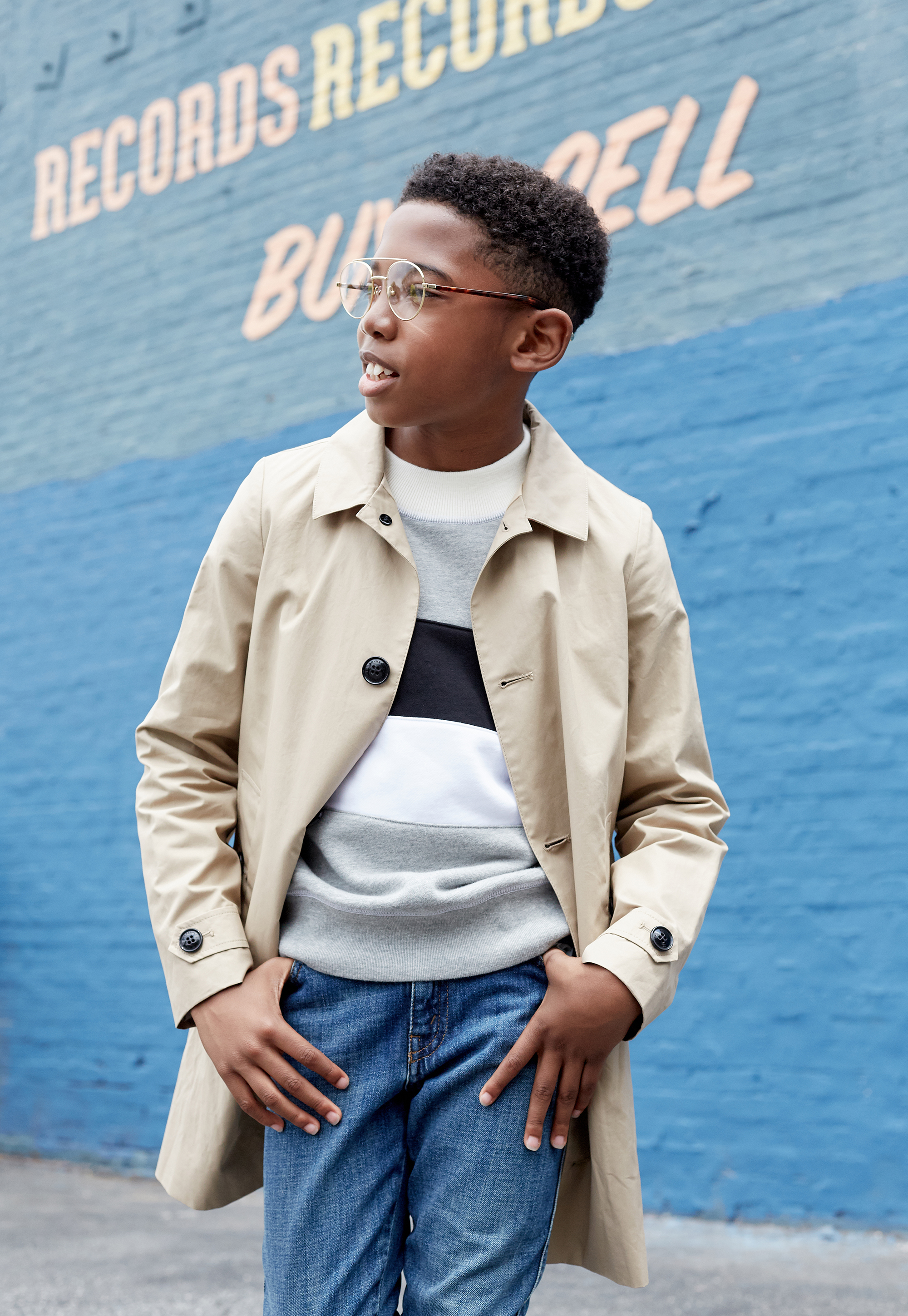 Seth Carr of Black Panther shot for Posh Kids Magazine featuring:  Trench Coat: Burberry Sweater: Burberry Denim: Gucci Shoes: Florsheim Glasses: Retrosuperfuture  Styling by: Angelique Fortuna  Grooming by: Renee Loiz  Photography by: Ryan Pavlovich