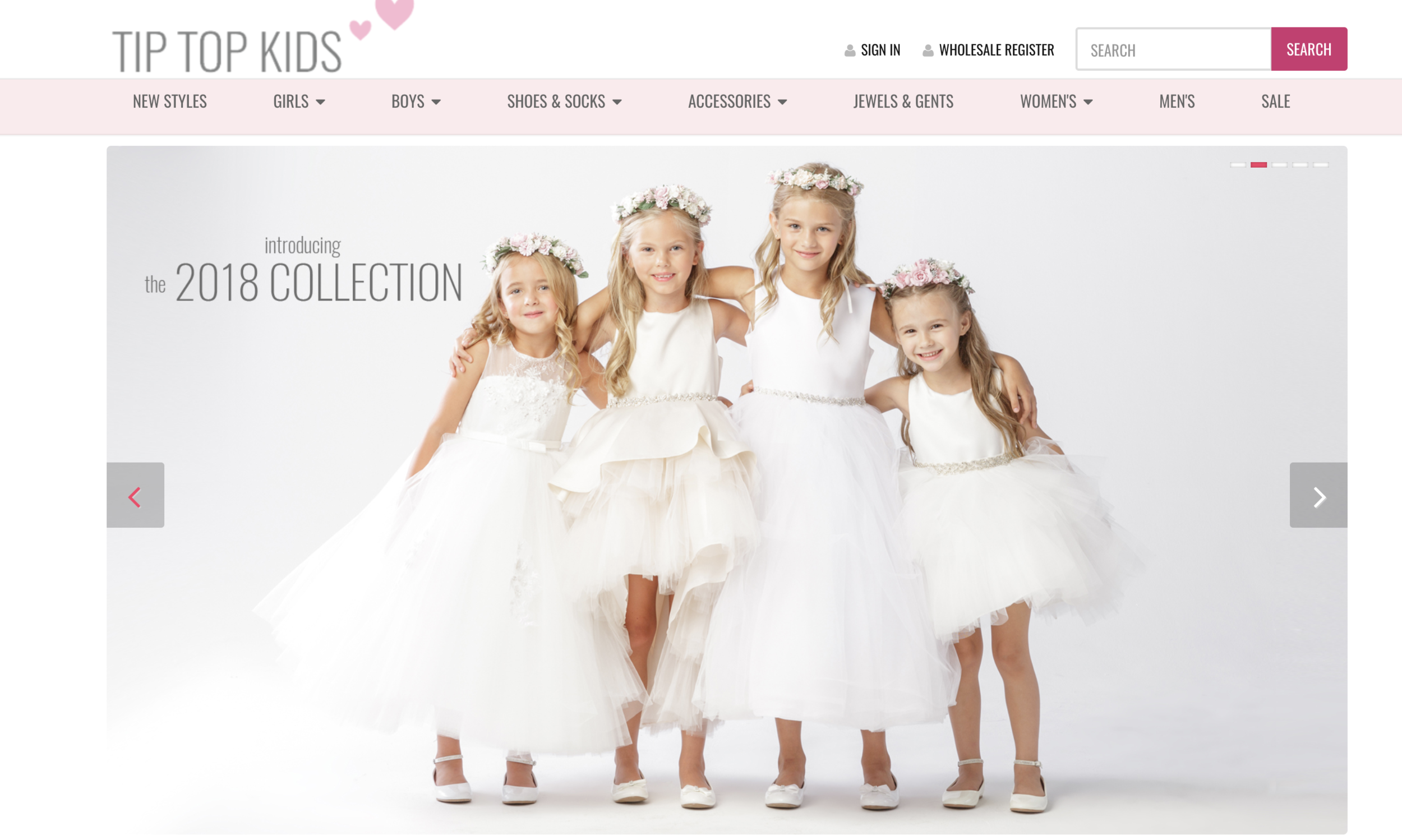 four young girls in white flower girl dresses by Tip Top Kids