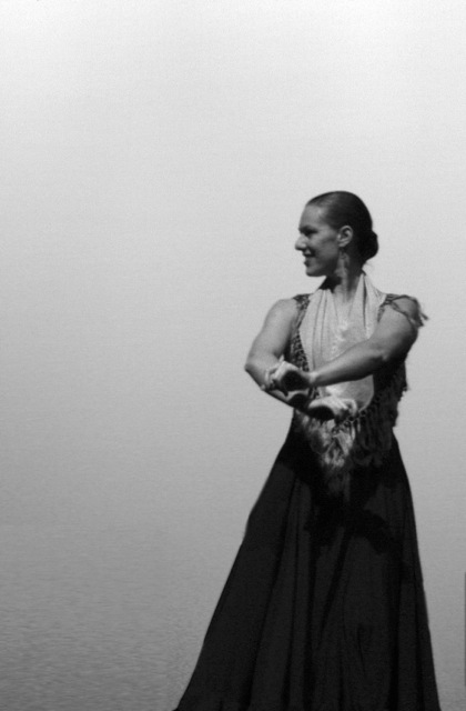 My husband shot this picture of me the very first time I performed on stage in Denver. It was a fun choreography to el maestro (may he rest in peace) Paco de Lucia: Entre dos aguas. I loved this shot because I was so conscious of keeping my arms in position  con aire .