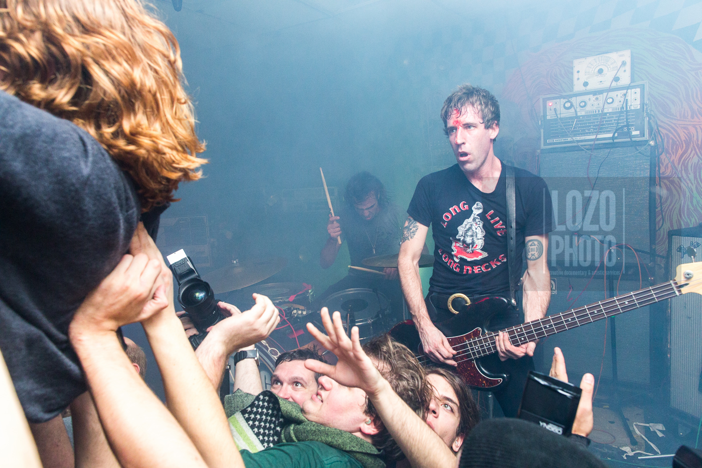 A bloody Dion Lundadon of   A Place To Bury Strangers   gets a good look at the mayhem his band is stiring up.