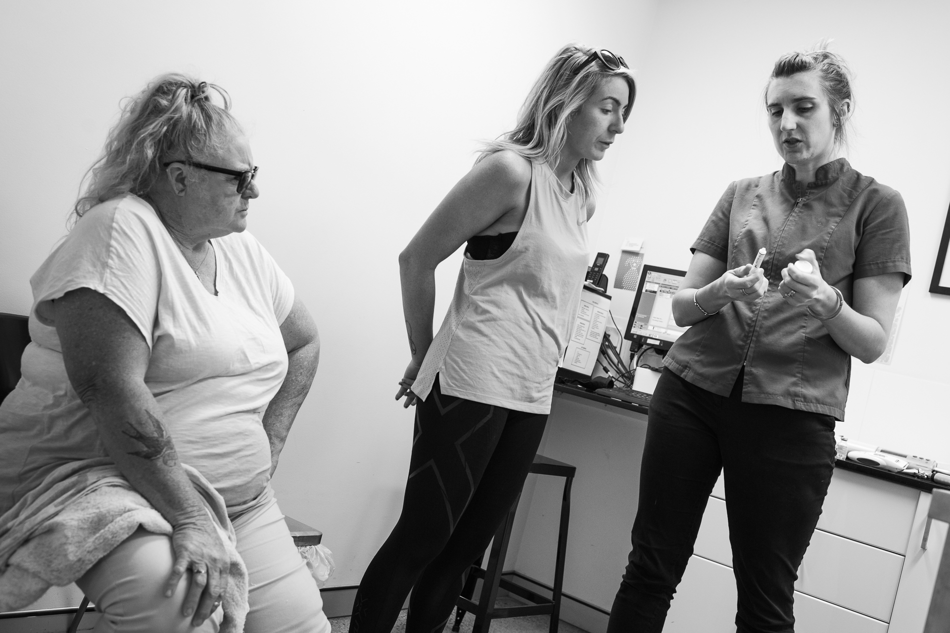 Amber Waters ( middle ) and her mother, Neridah, listen as Dr Louise Grey explains medications and doses to be given to Turbo, Amber's dog. Turbo was in earlier during the week for an invasive surgery to repair a significant spiral fracture to his rear-right tibia.  17 March, 2018.