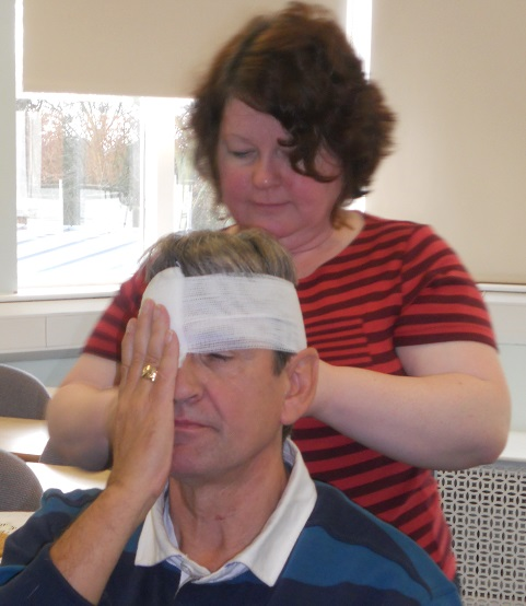 Annie is perfecting her bandaging skills, with Steven (Scarborough course, 2013)