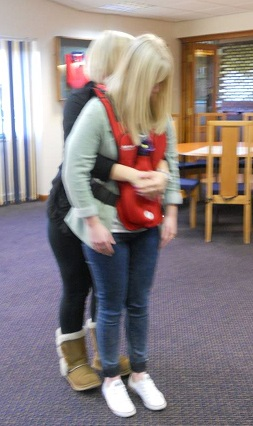 Abdominal thrusts, demonstrated by Alice and Emma (Bridlington course, 2013).