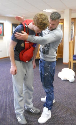 Working with the Choking Charlie: 5 backs slaps...followed by...     (with Harry and Rob, Bridlington course, 2013)