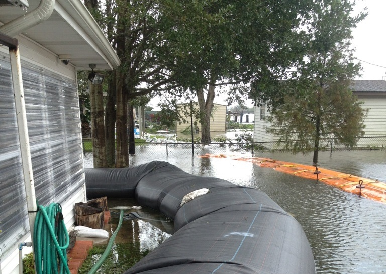 The Aqua-Dam helped one Texas homeowner keep his house dry, while all those around him got an unwelcome soaking.