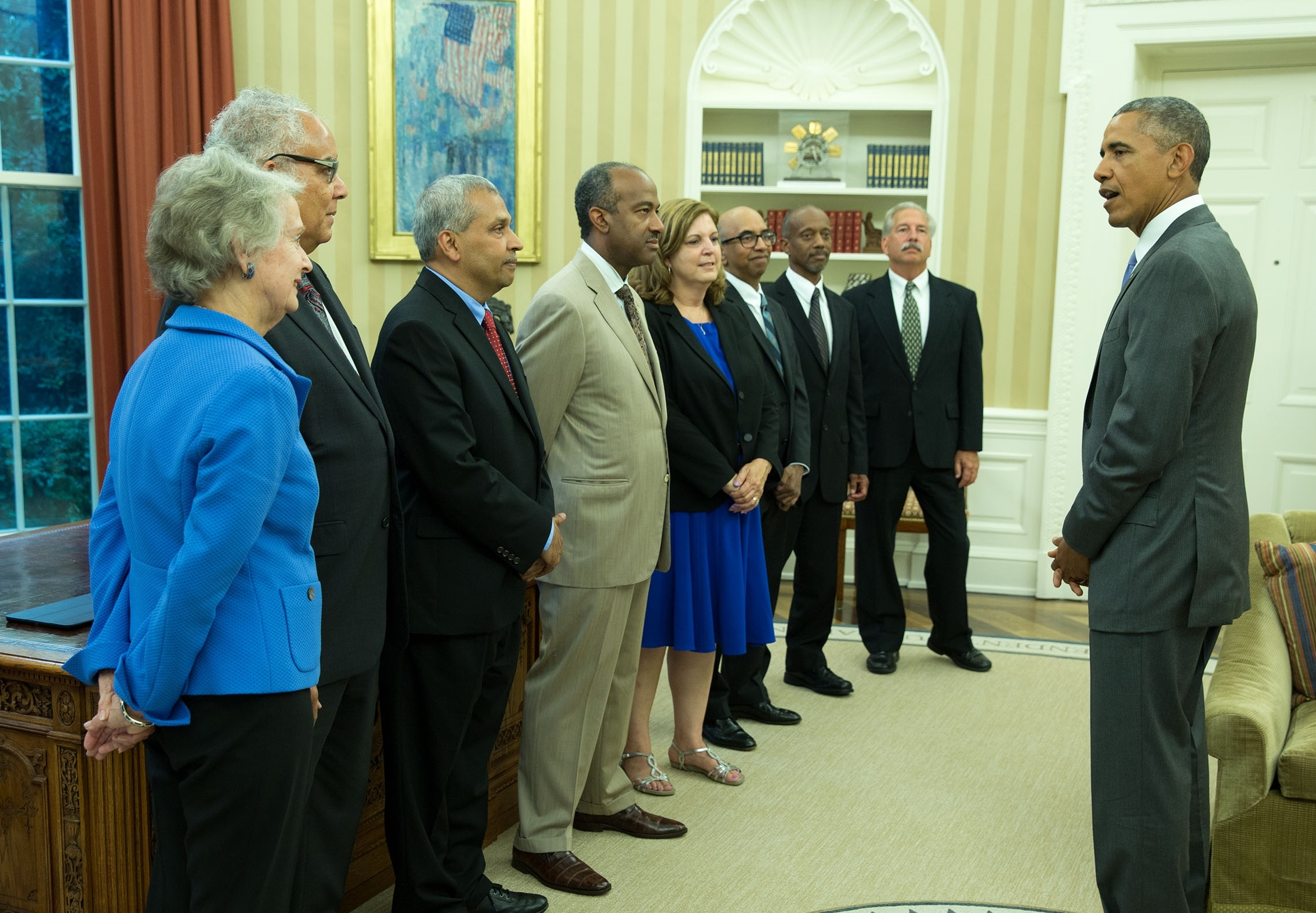 In June 2015, Liz Parry (5th from left) visited with President Obama and received the Presidential Award for Excellence in Science, Math, and Engineering Mentoring.