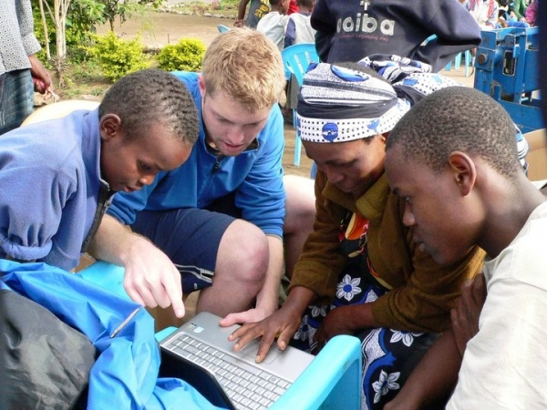 A Penn State engineering student helps Kenyan farmers find telemedicine resources, newly available in their village thanks to work done through the university's Humanitarian Engineering and Social Entrepreneurship Program.