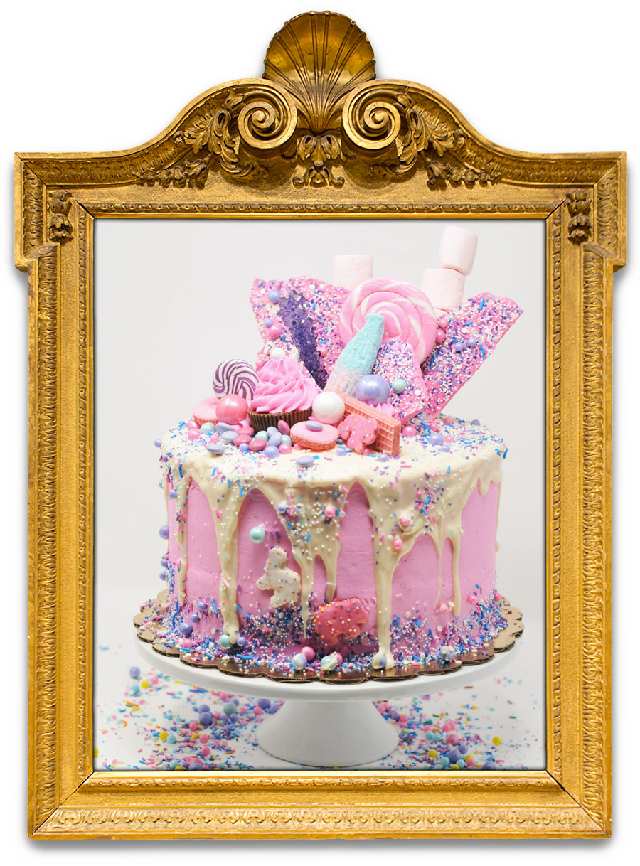 I ♥ CANDY (PINK)   A unicorn can only dream of a cake this good! White cake with pink buttercream, dripped with white chocolate, with every girlie candy imaginable on top, frosted animal cookies, pink vanilla wafers, and pink sprinkle chocolate bark.