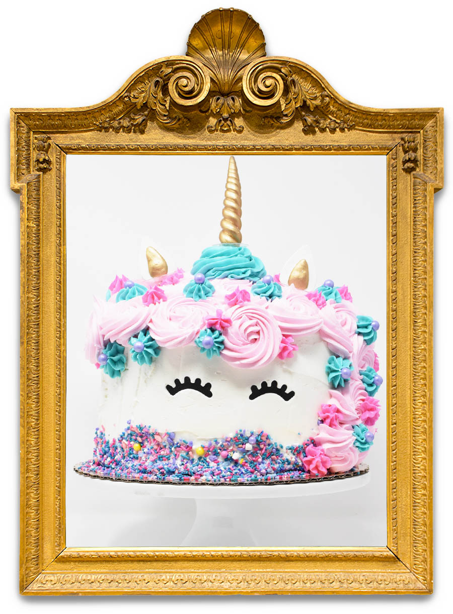 UNICORN   Enjoy a trip to make believe with this cute and tasty cake! White cake with white buttercream, colorful rosettes, and fondant ears and a gold horn. (chocolate cake available upon request as well)