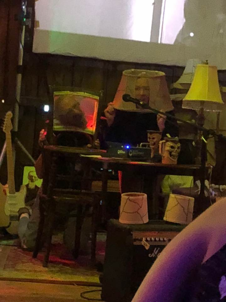 human lampshade and chair back up during the show.