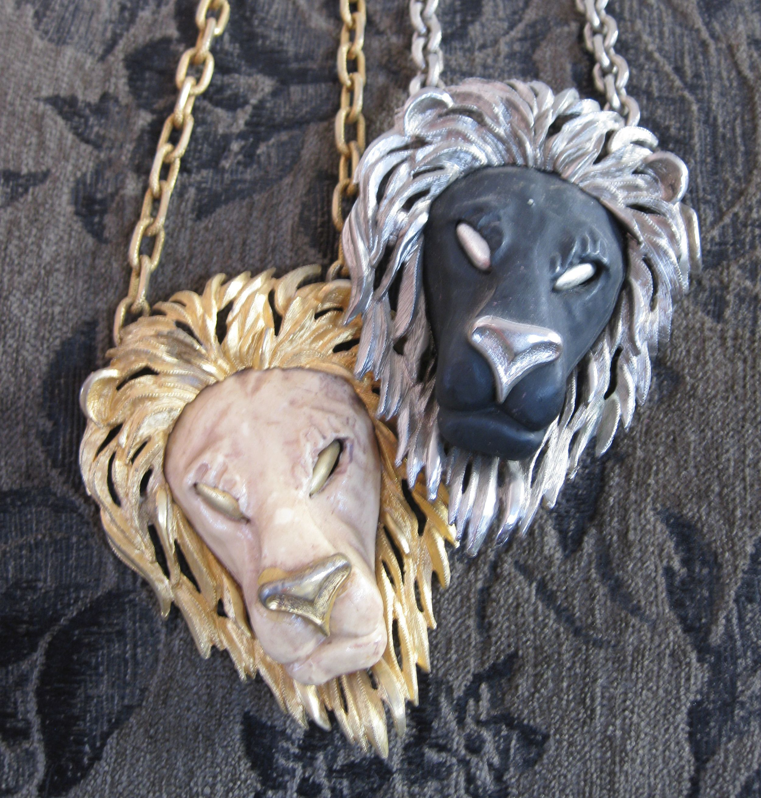 A duo of vintage Leo pendant necklaces, from the personal collection of the LEO DUO designers.
