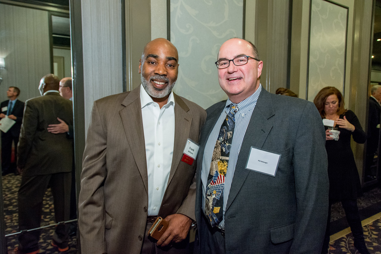 On left, Frank Williams, Boston Police Dept. Volley Against Violence Program Director with Phil Belanger, key contributor to Sportsmen's Club fundraising efforts and table host.