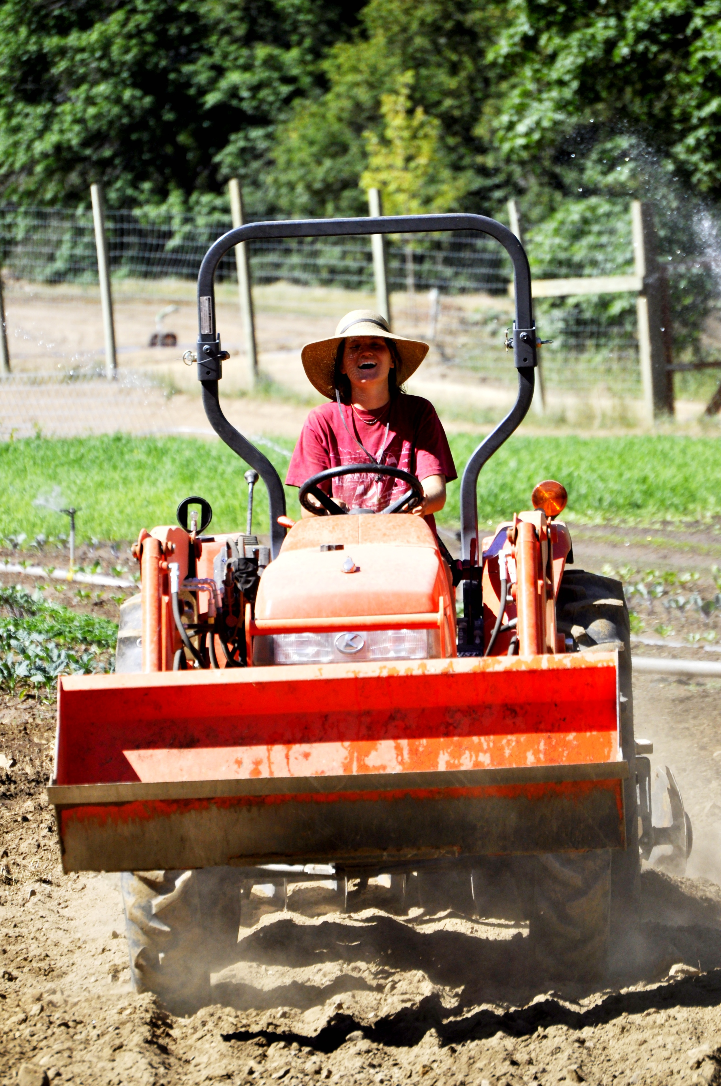Morgan prepping the ground at The Farmstead.