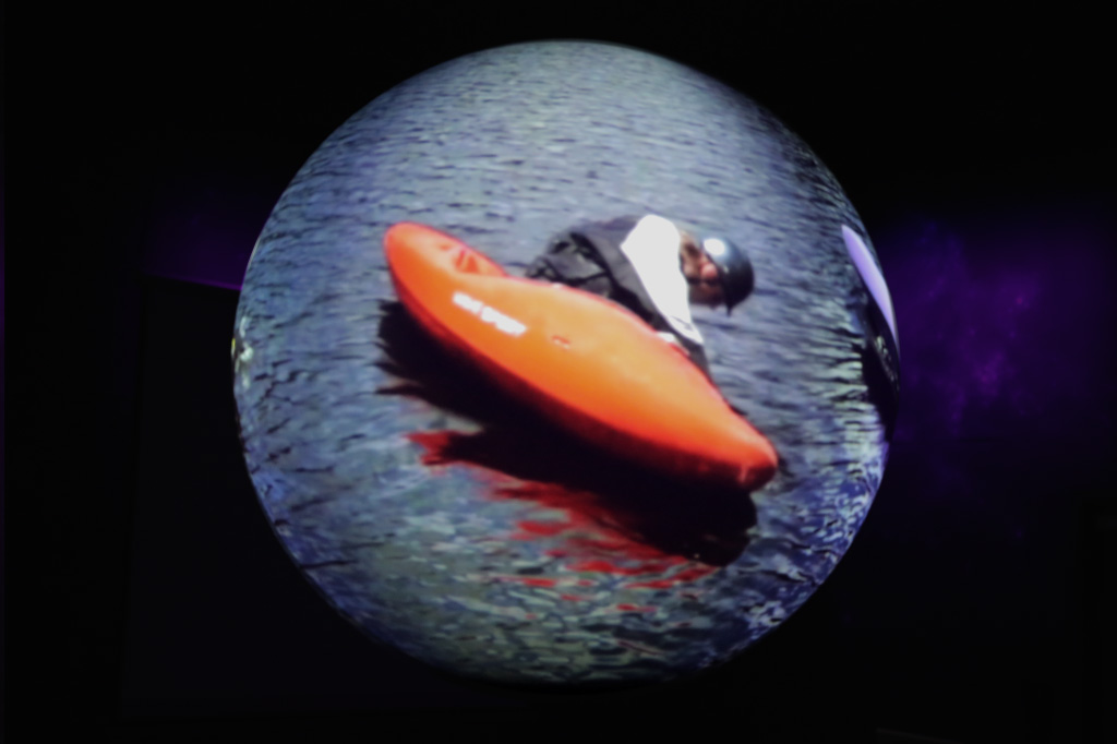 That's really a guy rolling a kayak on the sphere!