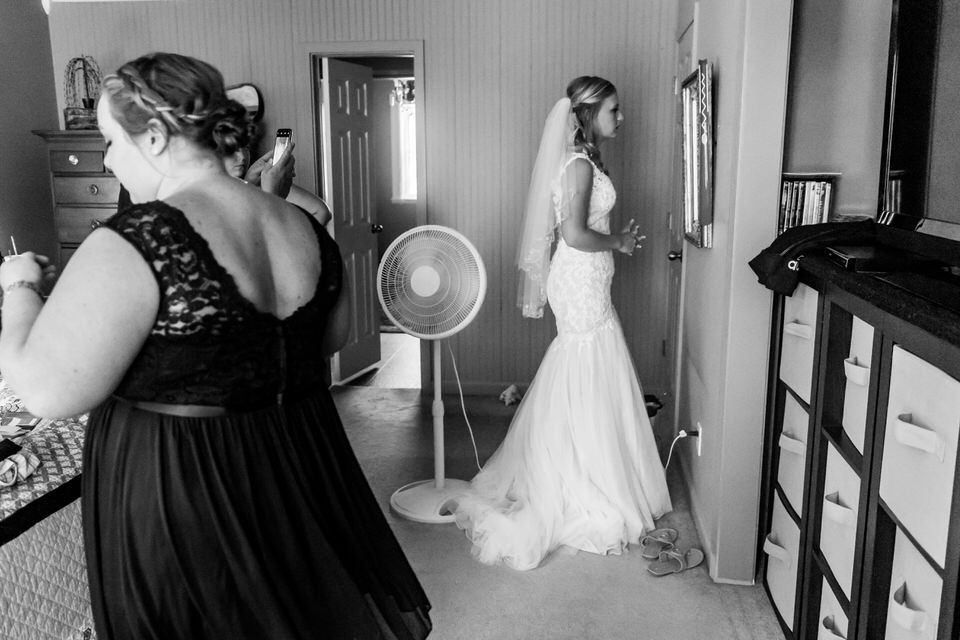 A bride checks the mirror before heading out to her wedding ceremony