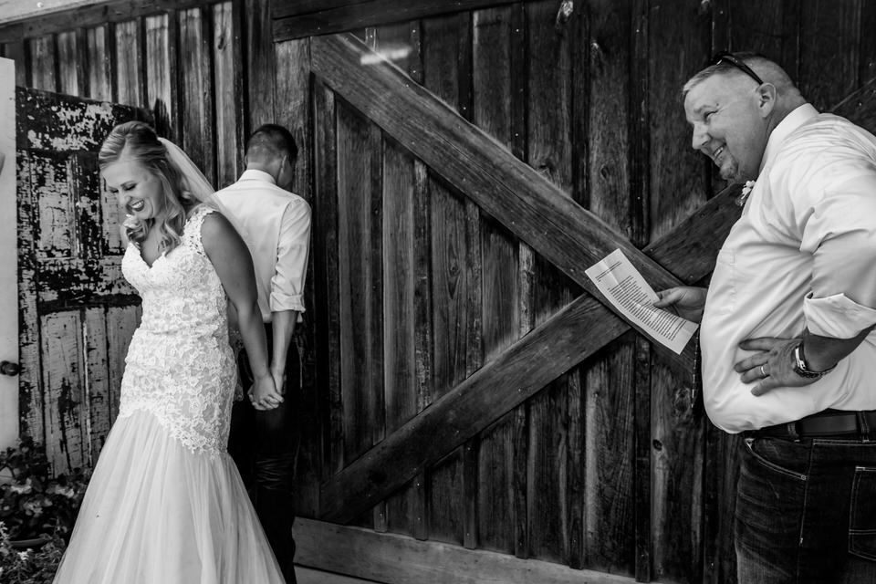 A bride and groom share a prayer before their wedding ceremony at Bridgeton Barn