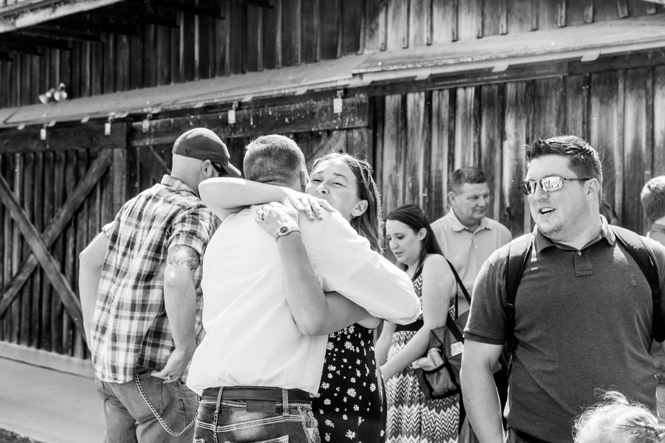 Guests mingle before the wedding ceremony at Bridgeton Barn