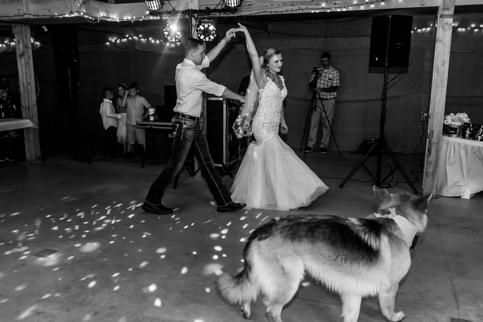 A bride and groom dance at their reception at Bridgeton Barn