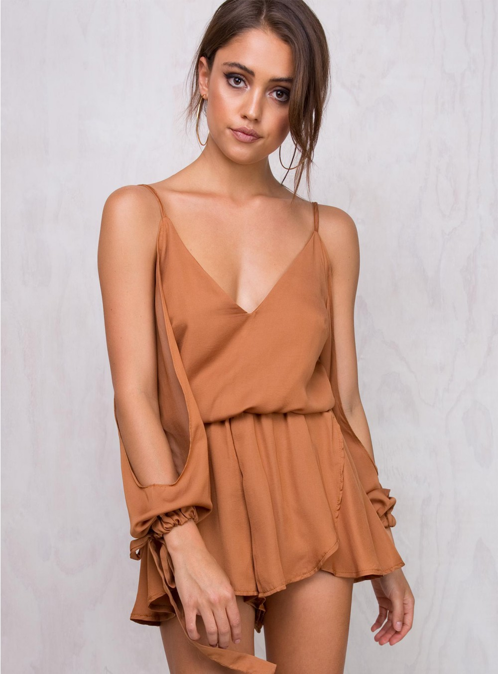 I'm not a huge romper fan but this bronze color and sexy details make it a STANDOUT   Bastian Playsuit  / Princess Polly / $60